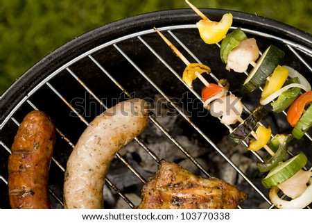 Grilling time! Grill, garden, green grass and good weather! - stock photo