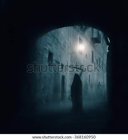 Grim reaper, the death itself, scary horror shot of Grim Reaper standing in a dark passageway
