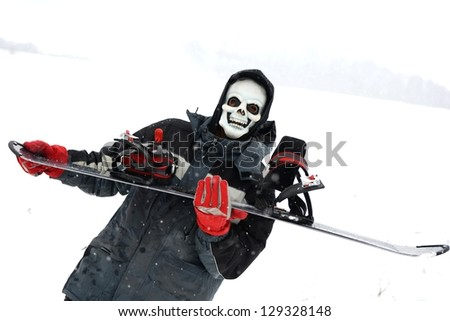 Grim reaper with snowboarder - stock photo