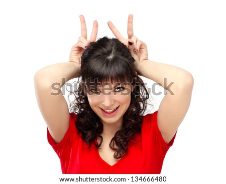 Grimacing.Funny woman doing hand sign.White background - stock photo