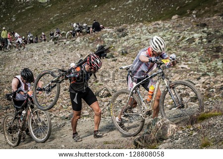 GRIMENTZ, SWITZERLAND � AUGUST 20: Unidentified riders in the Grand Raid tackle the gruelling Pas de Luna August 20, 2011. The event's 24th edition will be held on the 23 & 24 august 2013. - stock photo