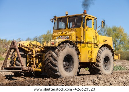 GRIMMEN / GERMANY - MAY 5, 2016: Russian Kirowez K 700 tractor on a track in grimmen, germany on may 5, 2016.