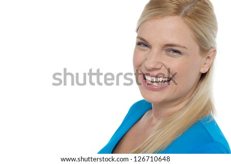 Grin of a gorgeous young laughing woman isolated on white background. - stock photo