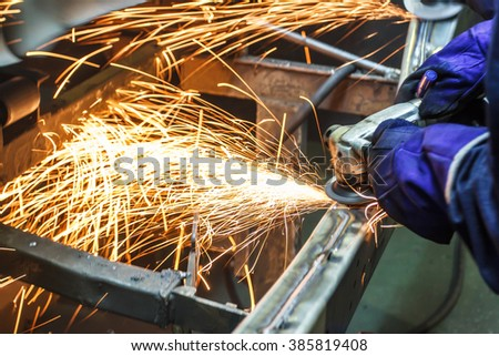grinding machine on work and spark movement in the automotive parts industry