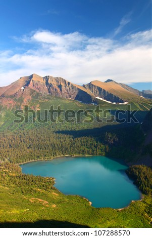 Grinnell Lake amidst the majestic mountain scenery of Glacier National Park in Montana - stock photo