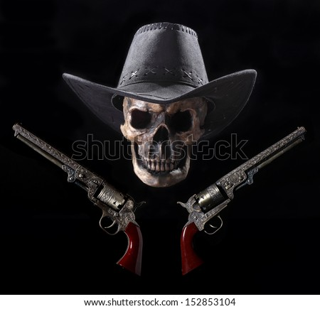 Grinning Cowboy Skull and Six-shooters - stock photo