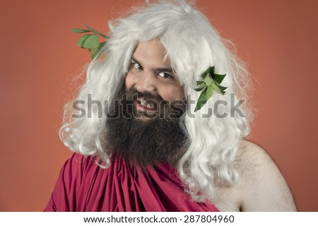 Grinning Zeus god or jupiter looks menacing against orange background - stock photo