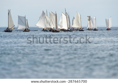 GRISSLEHAMN - JUN 13, 2015: Group of old sailing ships rowing towards the horizon from Grisslehamn (Sweden) to Eckero (Aland) in the public event Postrodden, June 13, 2015 in Grisslehamn, Sweden - stock photo