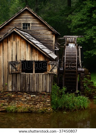 grist mill with water wheel - stock photo