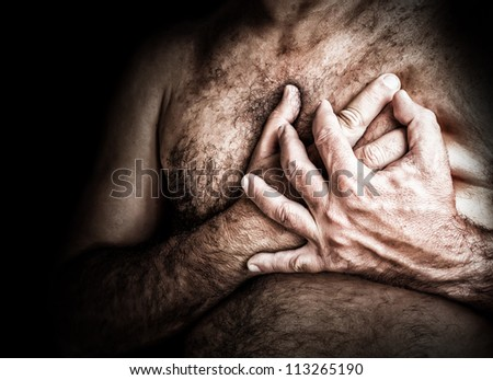 Gritty image of a shirtless man suffering from chest pain and grabbing his chest - stock photo