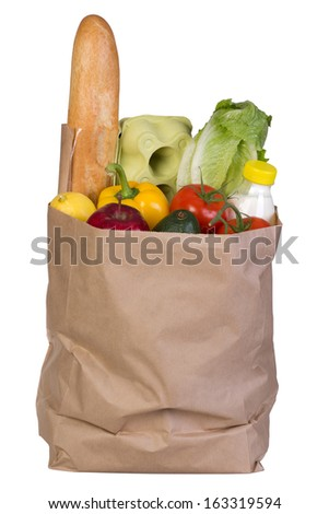 Groceries in paper bag isolated on white background - stock photo