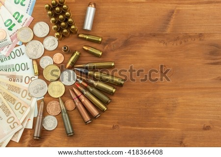 Grocery ammunition, weapons and ammunition sales. Valid euro banknotes and coins. Different types of ammunition. Preparing for war. - stock photo