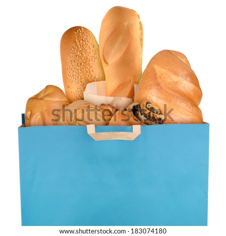 Grocery bag with fresh bread isolated on white background - stock photo