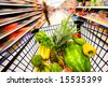Grocery cart filled with fruits and vegetables - stock photo