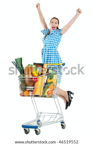 Grocery shopping with a happy young woman and a trolly full of fresh groceries.