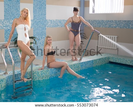 GRODNO, BELARUS - DEC 17: woman posing in a swimming pool in Grodno, Belarus, December 17, 2014