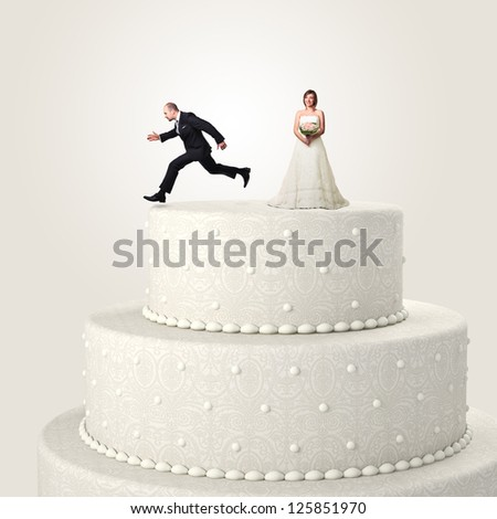 gromm try to escape jumping from the top cake - stock photo