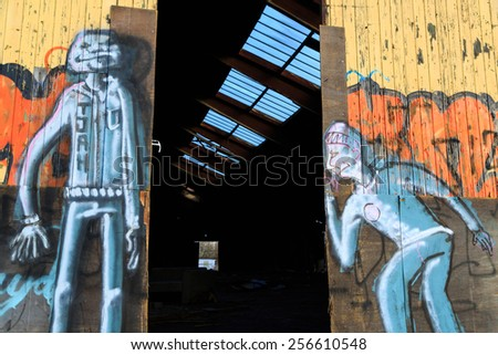 GRONINGEN, HOLLAND - FEBRUARY 27: Graffiti on doors of an old, abandoned warehouse, in Groningen, Holland on February 27, 2015. - stock photo