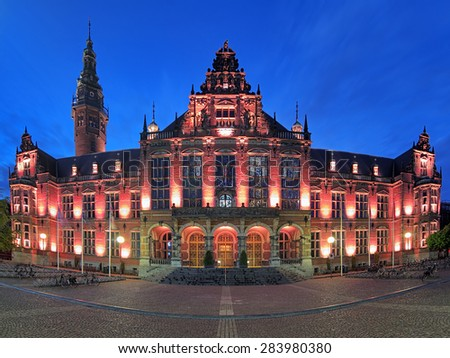 GRONINGEN, NETHERLANDS - MAY 25, 2015: Academiegebouw (Main building) of the University of Groningen at evening. It was built in 1907-1909 by design of the Chief Government Architect Jan Vrijman. - stock photo