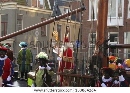 GRONINGEN, NETHERLANDS-NOV 19: Sinterklaas arrives in the harbor on Nov 19, 2012. The arrival of Saint Nicholas is a traditional event in the Netherlands - stock photo