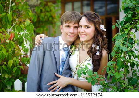 Groom and Bride in a park. wedding dress. Bridal wedding bouquet of flowers