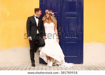 groom and bride posing in the city - stock photo