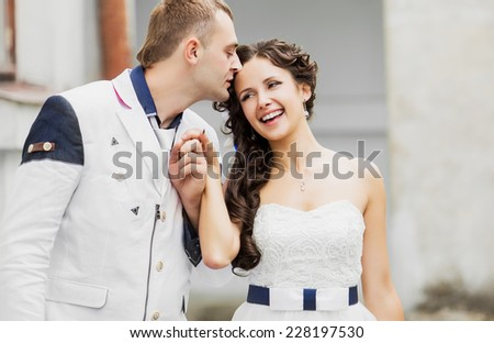 Groom and bride together having, portrait of a young wedding couple.