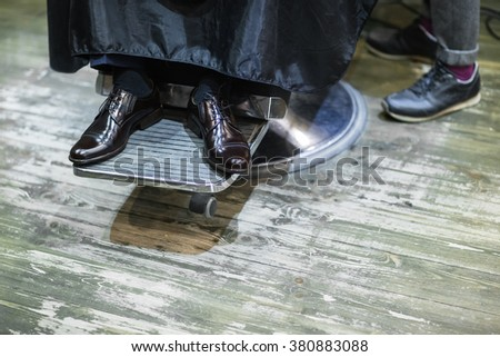 groom black shoes. groom wedding shoes in the beauty salon