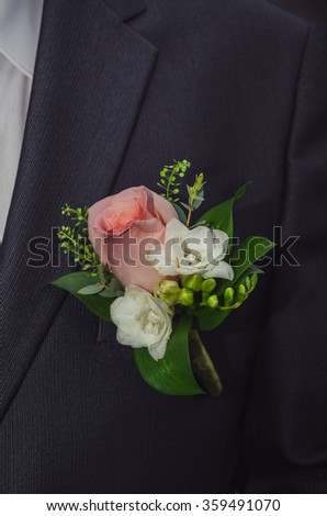 groom boutonniere in a jacket  - stock photo