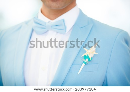 Groom button hole tropical wedding decoration stylish wedding marriage day Boutonniere On Jacket, man in wedding suit, soft focus. series - stock photo