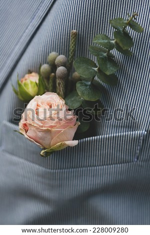 groom buttonhole in pocket of jacket - stock photo