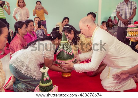 Groom foreigners The bride with a wedding ceremony in Thailand on July 17, 2016 at Nong Sarai in Pak Chong district of Nakhon Ratchasima .