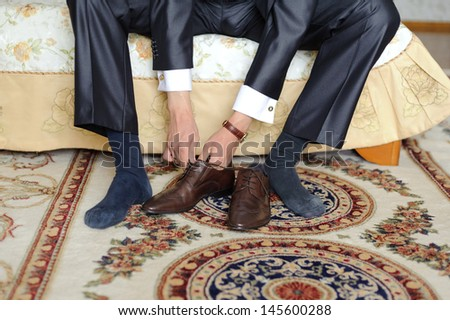 groom getting ready for wedding at home