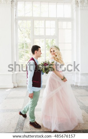 groom gives the bride a bouquet