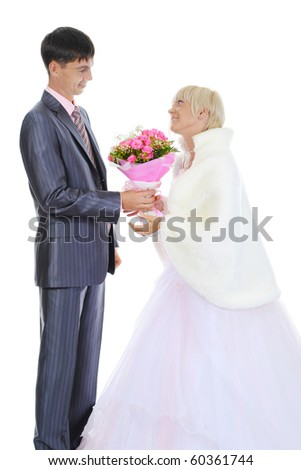 groom gives the bride a bouquet of roses. Isolated on white background - stock photo