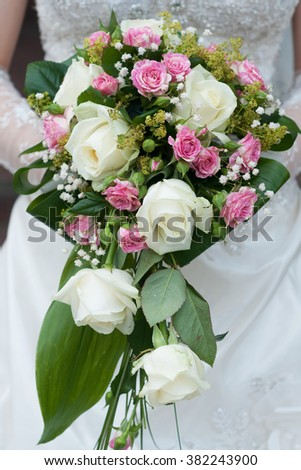 Groom gray jacket with white flower - stock photo
