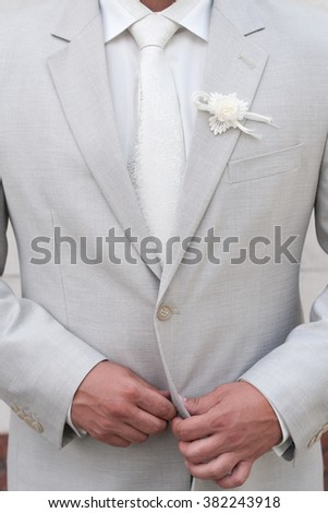 Groom gray jacket with white flower