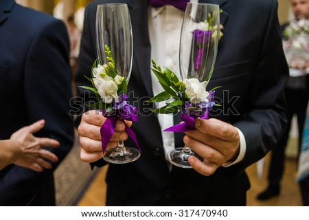 groom holding champagne on wedding ceremony