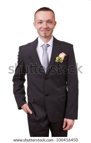 Groom holding hand in his pocket, isolated in white