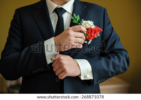 groom in a shirt and tie in the morning wears cufflinks. - stock photo