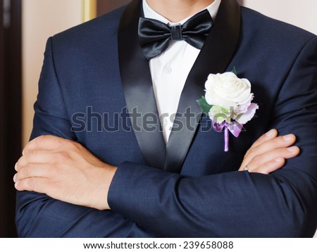 groom in blue suit with atlas bow - stock photo