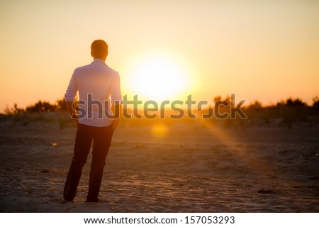 Groom in the rays of the setting sun