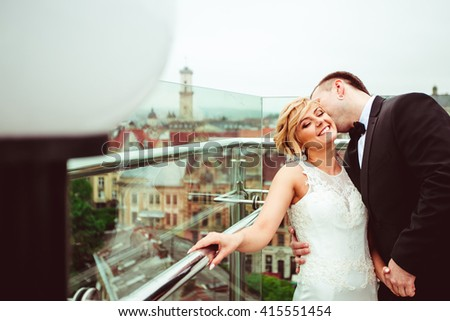 groom kissing charming young wife - stock photo