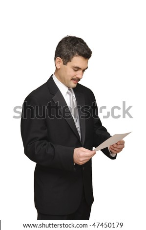 groom looking at marriage license isolated on white