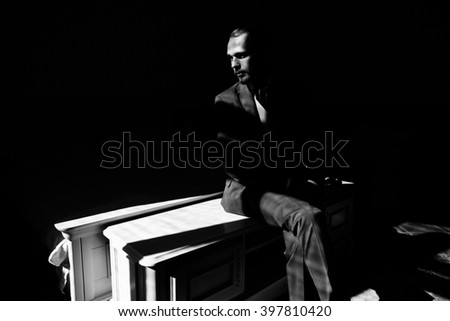 Groom portrait in bedroom at a wedding day. Black and white