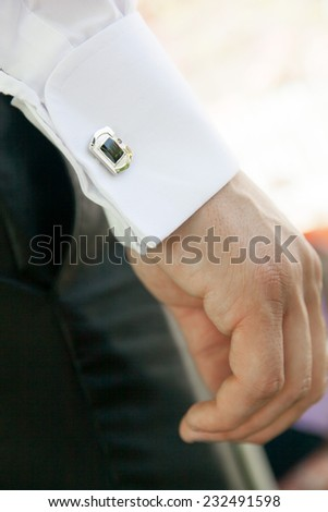 Groom prepares for wedding - stock photo