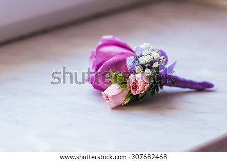 Groom's boutonniere closeup. Wedding boutonniere of roses - stock photo