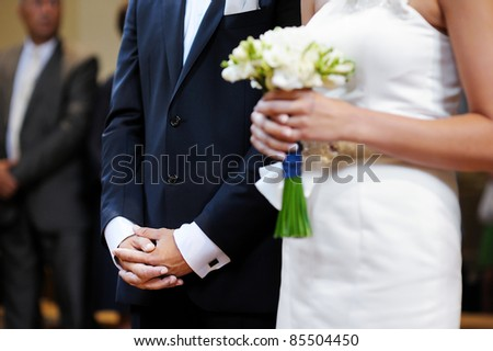 Groom's hands during the wedding ceremony