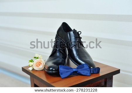 Groom's shoes bow tie - stock photo