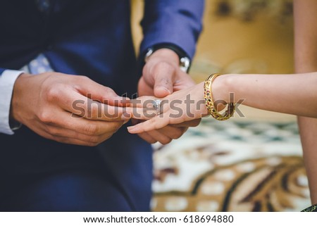 Groom Wearing Wedding Ring On Brides Stock Photo 618694880